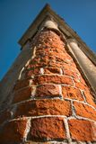 Old column of an abandoned Palace. Cracked concrete vintage brick wall background Royalty Free Stock Image