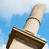 Old column in the clo udy sky of europe italy Stock Photos
