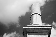 Old column in the cloudy sky of europe Royalty Free Stock Photos