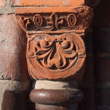 Old column head in red sandstone Stock Photos