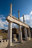Old columns. Pompeii ruins and blue sky stock image