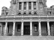 Old Columns in Black and White. The back view of the government buildings in Victoria, BC in black and white Stock Images