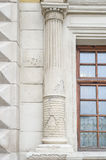 Old columns on a building with a crack.  Stock Photo