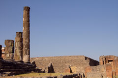 Old columns at Pompeii. Old columns at Pompei with a lot of space on the sky area of the picture Stock Photo