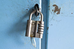 Old combination lock on the door Royalty Free Stock Photos