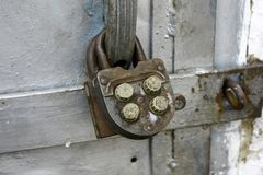 Old combination lock on metal old doors, close-up stock photo