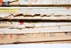 Old Comic Books. A stack of old comic books very tattered and used Stock Image