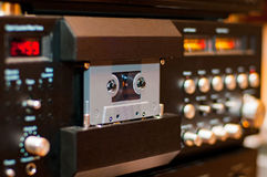 Old compact audio cassette in vintage audio system with tape rec royalty free stock images