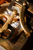 Old compas in brass sun clock Royalty Free Stock Photo