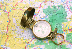 Old compass. On the map background Stock Photos
