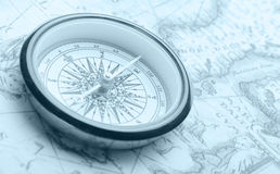 Old compass on ancient map stock photo