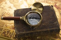 Old compass and book Royalty Free Stock Photography