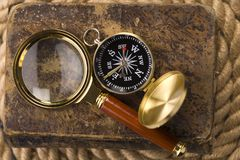Old compass and book Royalty Free Stock Photo