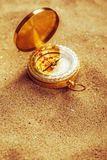 Old compass in dry desert sand, macro shot Royalty Free Stock Photography
