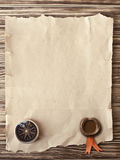 Old compass on grunge background with a wax seal and ribbon Royalty Free Stock Photo