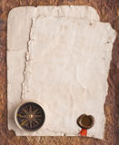 Old compass on grunge background with a wax seal and ribbon Stock Images