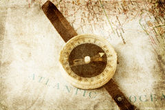 Old compass on map. Grunge background stock photos