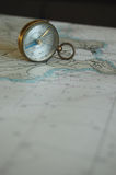 An old compass and a map Stock Images