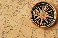 Old compass and map Royalty Free Stock Photo