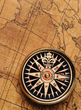 Old compass and map Stock Photos