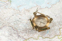 Old compass on map Stock Images