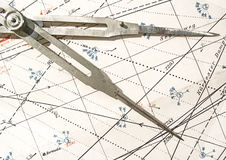 Old compass on a navigation chart Stock Image