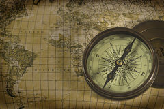 Old compass over map Stock Photos