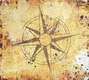 Old compass on paper background Stock Photos