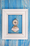 Old Compass in Photo frame on blue background Stock Image