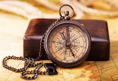Old compass. Old retro compass on vintage map Stock Photography
