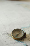 An old compass on the right corner !. An old compass on the right corner of a map Royalty Free Stock Images