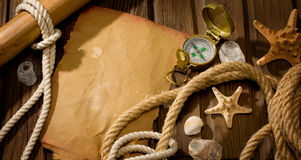 Old compass and rope Stock Images