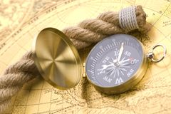 Old compass and rope Stock Photos