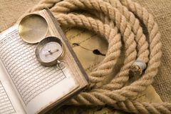 Old compass and rope Royalty Free Stock Photo