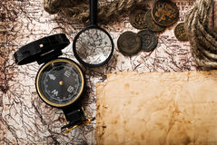 Old compass, rope and coins on grunge background Stock Photos