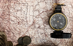 Old compass, rope and coins on grunge background Royalty Free Stock Images