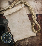 Old compass and rope on grunge background Royalty Free Stock Photography