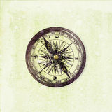 Old compass on the shabby background Royalty Free Stock Photos