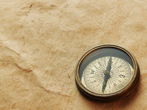 Old compass on vintage background Royalty Free Stock Images