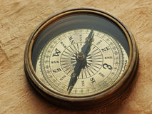 Old compass on vintage background Stock Photos