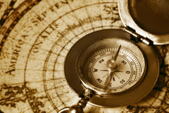 Old compass on vintage map. Photo of a old compass on vintage map Royalty Free Stock Photos