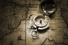 Old compass on vintage map royalty free stock photography