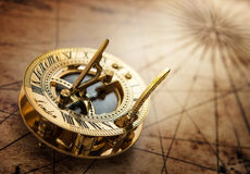 Old compass on vintage map. Royalty Free Stock Images