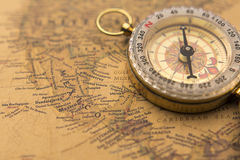 Old compass on vintage map selective focus on Mexico. Compass on vintage map selective focus on Mexico stock images