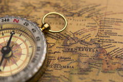 Old compass on vintage map with selective focus on Venezuela Stock Image