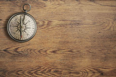 Old compass on vintage wooden table top view royalty free stock image