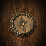 Old  compass on  wood  background Stock Photos