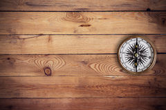 Old compass on wood background and texture Stock Photos