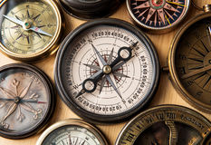 Old compass on wood desk. Stock Photography