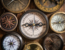 Old compass on wood desk. Royalty Free Stock Image